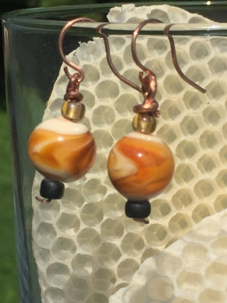E4 $25 Amber on ivory glass beads with copper and seed bead accents. These hang about 1 inch.