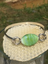 B6 $45 This bangle hook bracelet has a sterling silver bangle with a beautiful green focal glass bead.