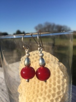 E19 $25 Beautiful red glass beads with sterling silver accents. These hang about 1 and 1/4 inches.
